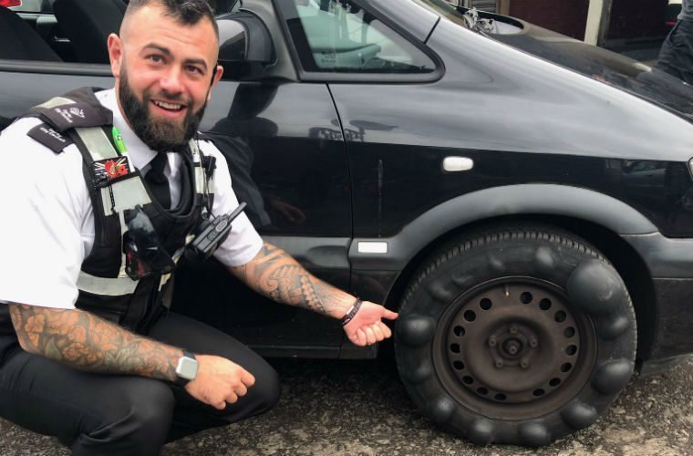 Driver with lumpy tyre pulled over on school run